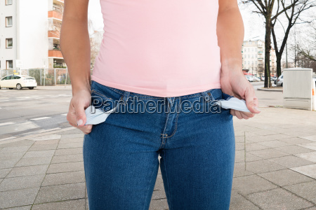 woman showing empty pocket