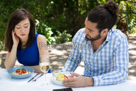 couple having relationship difficulties at restaurant