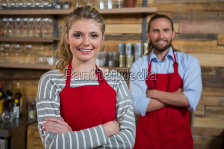 smiling female barista with male coworker