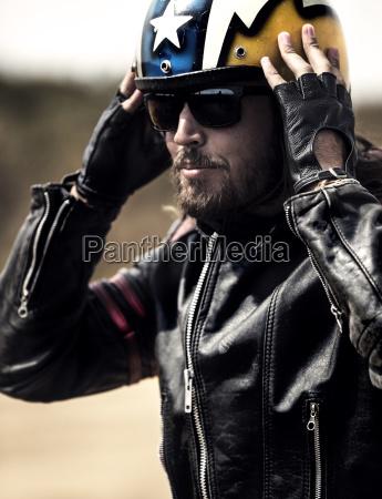 bearded man wearing black leather jacket