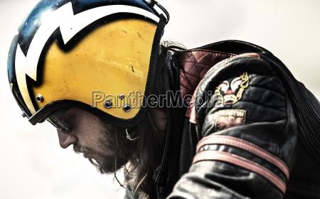 profile of bearded man wearing yellow