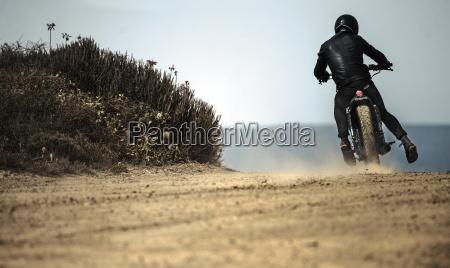 rear view of man wearing crash