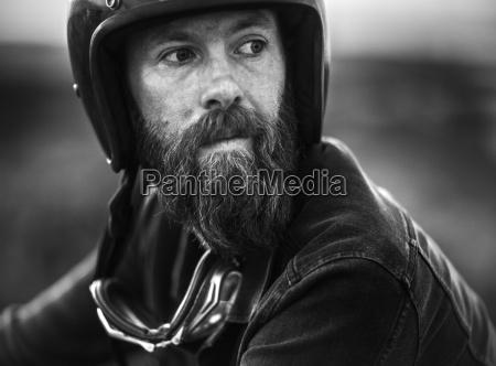 portrait of bearded man wearing open