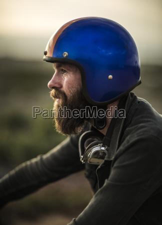 profile of bearded man wearing blue