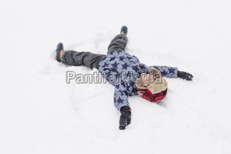 high angle view of boy lying