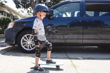 side view of boy wearing crash
