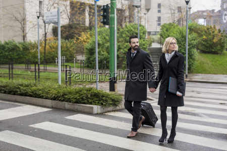 business couple in the city crossing
