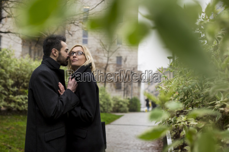 affectionate business couple in the city