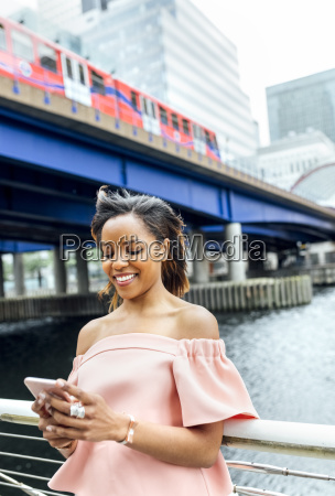 smiling woman sending messages with her