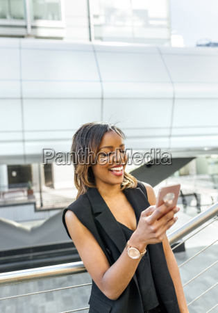 smiling woman looking at her cell