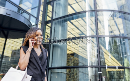 smiling woman on the phone outside