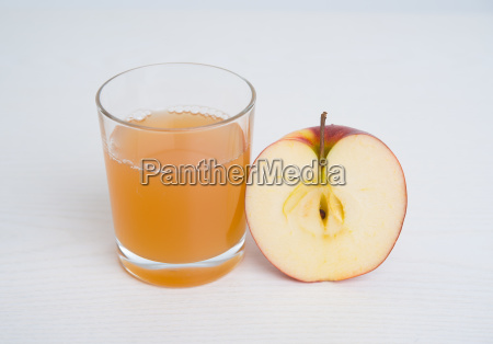 half apple with glass of naturally