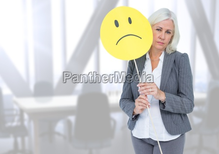sad businesswoman against bright office