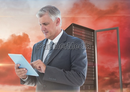 digital composite image of businessman using
