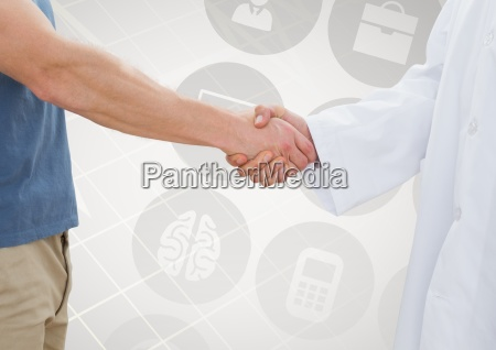 man shaking hand with doctor against