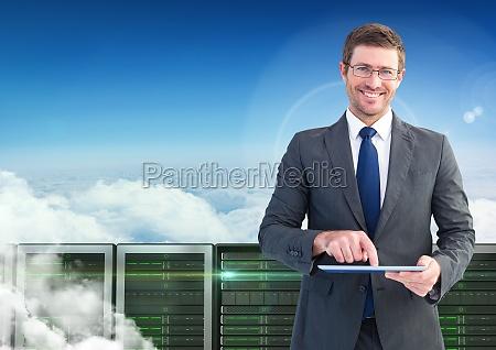 businessman using digital tablet against database