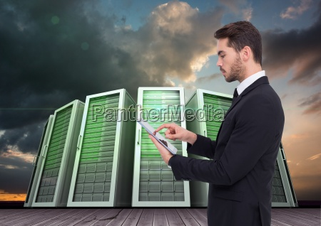 businessman using digital tablet against server