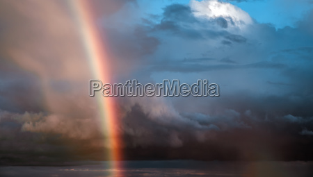 sky rainbow sunrise cloudy background