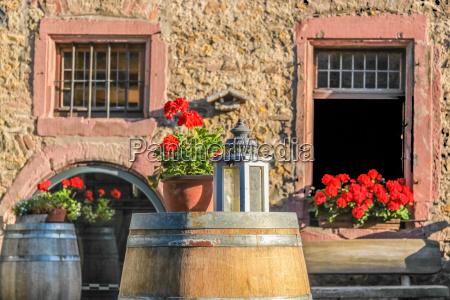 large wooden barrel on a vineyard