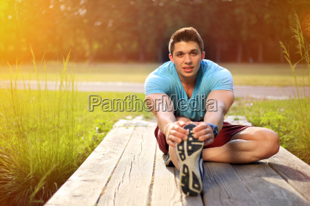 young man stretching running jogging sport
