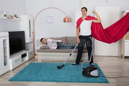 woman looking at her husband cleaning