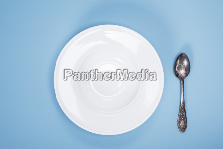 empty plate for soup and iron