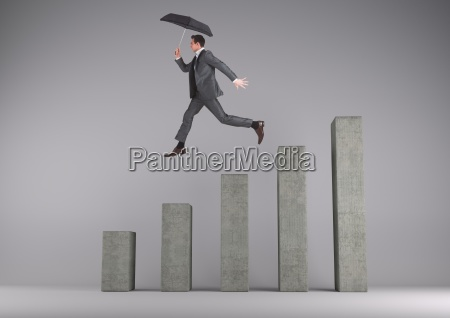businessman holding an umbrella jumping on