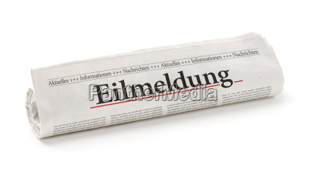 newspaper roll with the heading breaking