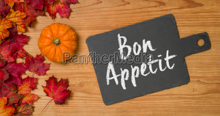 autumn leaves with pumpkin on a
