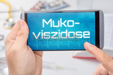 smartphone mit dem text mukoviszidose auf