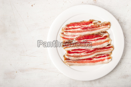 streaky bacon with black pepper on