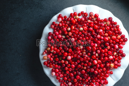 red cranberries on a large white