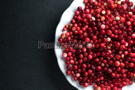 red cranberries on a ceramic white