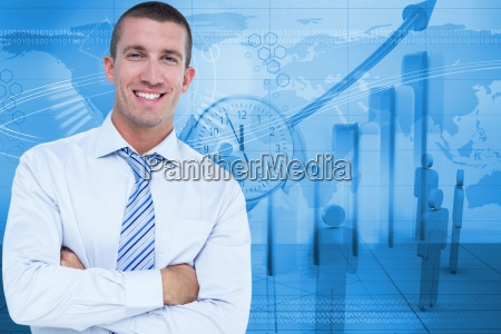 portrait of businessman standing arms crossed