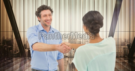 male and female colleagues shaking hands