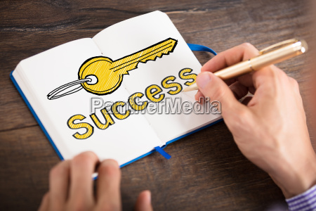 businessperson writing on personal diary
