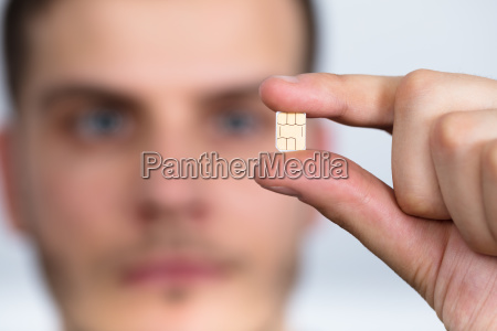man holding nano sim card
