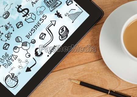 tablet on desk with coffee showing