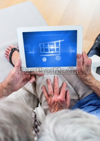 old people using tablet with shopping