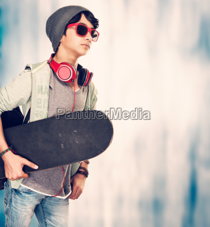 stylish guy with skateboard