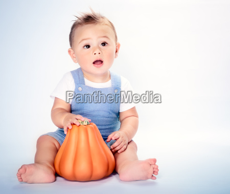 happy boy with thanksgiving pumpkin
