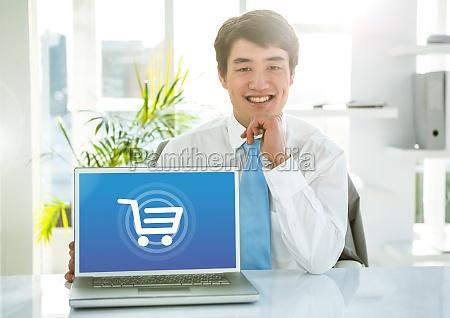 mann mit laptop mit einkaufswagen ikone