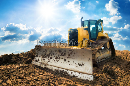 excavator with blue sunny sky in