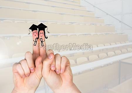 finger absolvent zeichen studenten im hoersaal