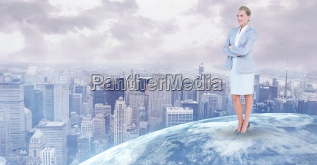 businesswoman standing on globe against city