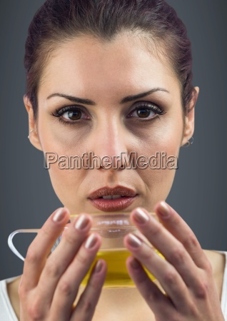 close up of woman drinking tea