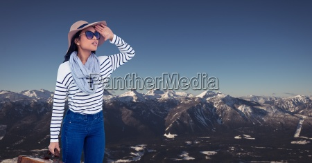 young woman traveling on snow mountains