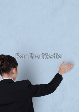 rear view of businesswoman touching blue