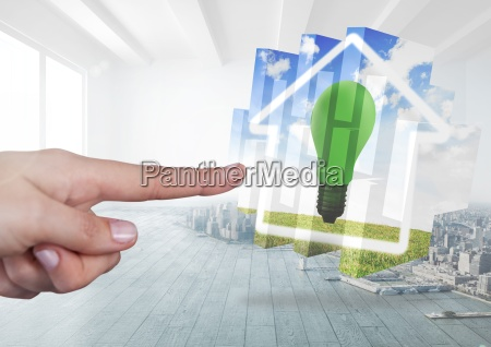 hand touching a home with green
