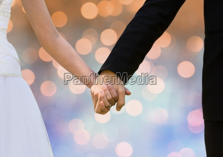 couple hands holding wedding couple with